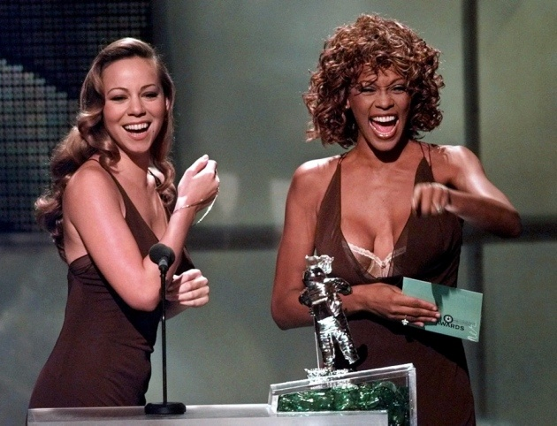 Two divas: Mariah Carey presented the Best Male Video award with Whitney Houston during the 1998 MTV Video Music Awards in California. Associated Press photo