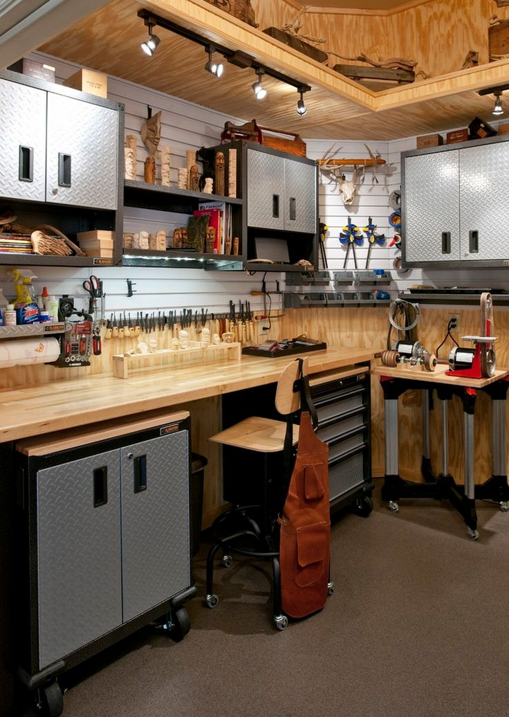 Like the idea of lowering the ceiling just over the workbenches for better lighting and tool storage.