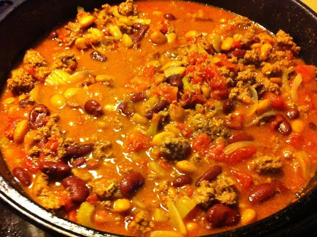 Cast Iron Dutch Oven Chili...OH MY GOSH!! This is SO SO SO good! Jared got seconds, and didn't even put shredded cheese OR sour cream in it (he said it would ruin the flavor, that's a huge compliment) I didn't use the bay leaves because I didn't have any, only 1 can of diced tomatoes, then added a fresh diced tomato and a little extra chili sauce. I browned the meat in a skillet first to speed things up, and let it simmer for about 2 hours!