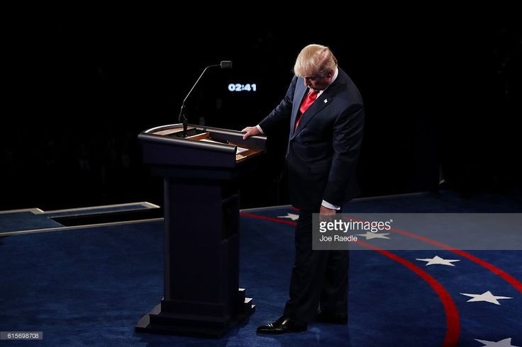 Republican presidential nominee Donald Trump looks down at the podium during the third U.S. presidential debate at the Thomas & Mack Center on October 19, 2016 in Las Vegas, Nevada. Tonight is the final debate ahead of Election Day on November 8.
