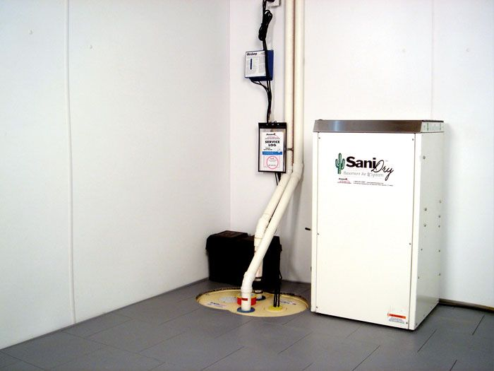 Our basement dehumidifier system installed in a dry, waterproofed basement.
