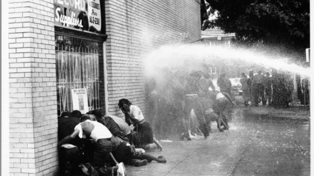 African American children are attacked by dogs and water cannons during the 1963 Birmingham Campaign, a protest against segregation. (photo: Michael Ochs Archives/Getty Images)