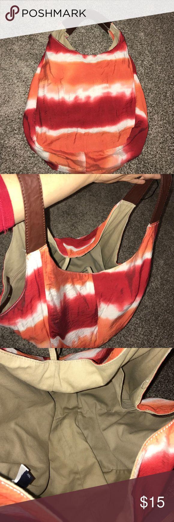 Gap tie dye oversized bag Super cute Gap over sized tie dye bag. Has orange, red, white tie dye design and beige lining with brown handles. GAP Bags Hobos