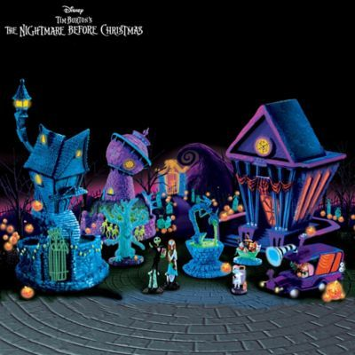 $70- Wonderfully wicked collection of handcrafted buildings from Halloween Town with eerie black light effect. FREE figurines and accessories, a $70 value!