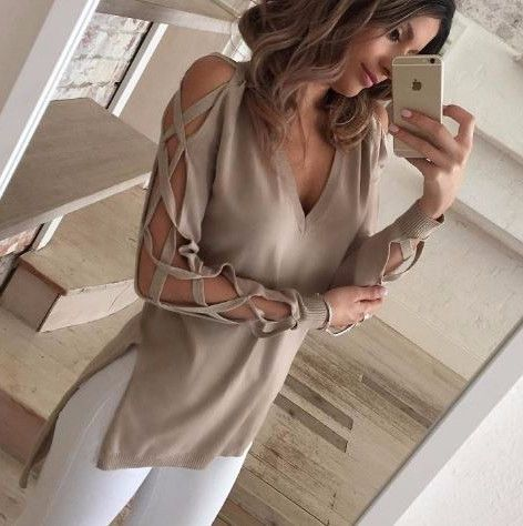 Featuring its cut out long sleeve, v-neckline, side slit, hi-low hemline. Crafted cotton, spandex, acrylic material. Great for the not so cold yet not so warm weather. A top that can go well with any