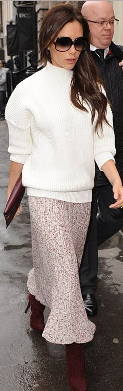 Who made Victoria Beckham's white sweater, black sunglasses, and red clutch…
