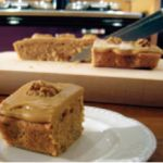 Ingredients 300g/11oz Odlums Self Raising Flour 1 Level Teaspoon Baking Powder 225g/8oz soft Margarine 225g/8oz Caster Sugar 4 Eggs 3 Teaspoons instant coffee dissolved in 2 tablespoons hot water 100g Packet of chopped Walnuts 50g/2oz Butter (melted) 2 Teaspoons instant…