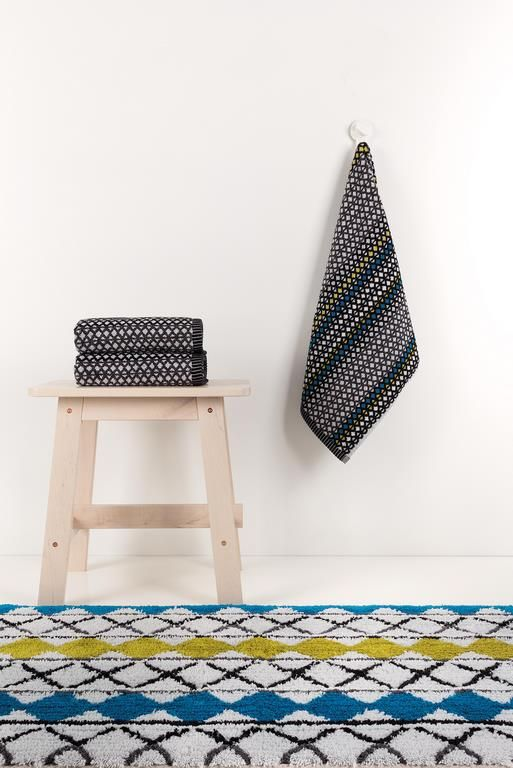 Grid bath towels and path rugs. Part of our Urban Explorer bath concpet with different shapes, different lines and mainly warm dark tones that never disappoint or compromise.