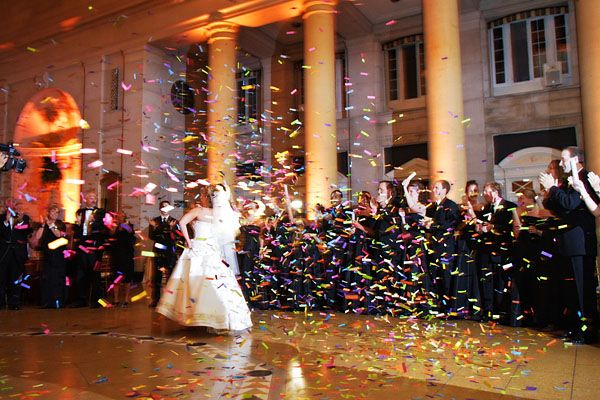 Bride And Groom S Grand Entrance: Bride And Groom Making A Grand Entrance With Confetti At