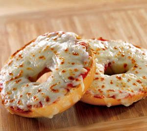 Bagel Pizzas  Things you need:  Bagels  tomato-based sauce  shredded mozarella cheese