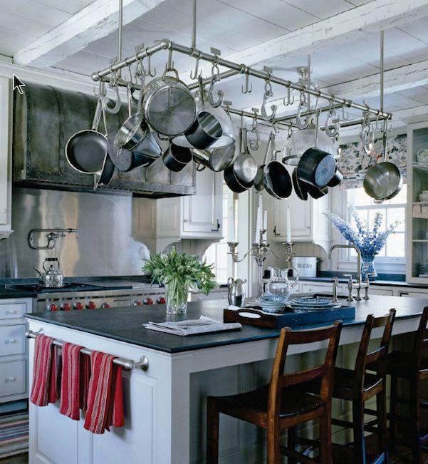 Suzie: Cote de Texas - Industrial kitchen design with zinc barrel range hood with forged iron ...
