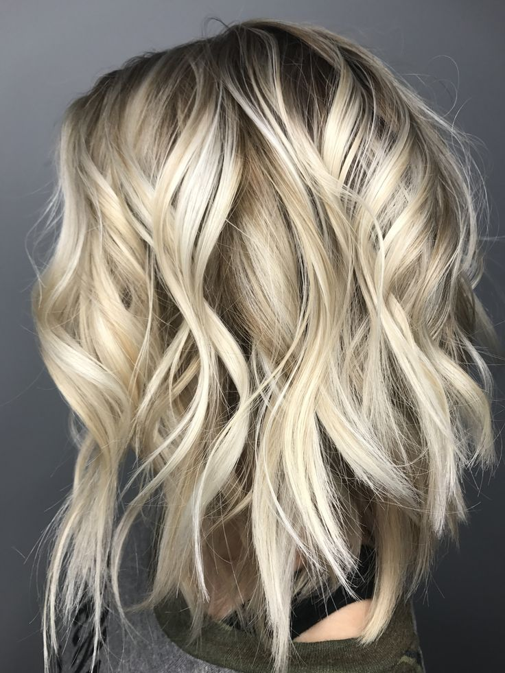 Blonde hair with dark roots. I have used a dark blonde at the scalp and melted it thru then hair. Brightening up the ends with a lighting and glossy toner. Jessica Wilson KC hair stylist