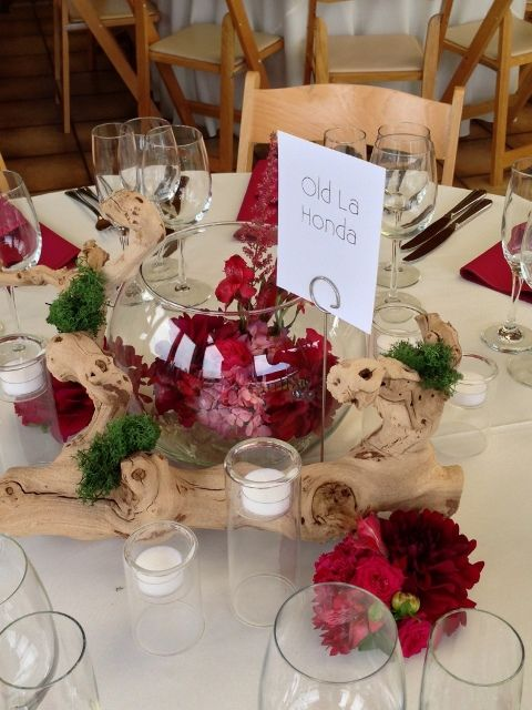 A grapewood branch centerpiece gently wraps around large