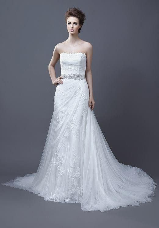 - A line - Lace applique detail along front of tulle skirt - Zipper back - Sweetheart neckline - Floor length - Court train *NOTE* There are no sizes listed, because our wedding attire is custom made