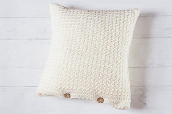 This plain cushion cover has a subtle hint of texture and looks gorgeous alongside farmhouse and country decor. Combine this cream cushion cover with other neutral cushions or tartan check fabrics. DETAILS AND FEATURES - Created using a textured crochet stitch. - Features an envelope