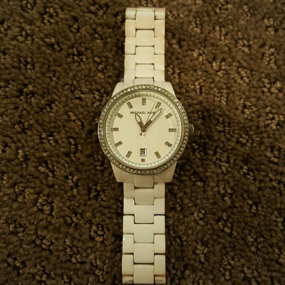 White Michael Kors Watch White Michael Kors Watch, does have some wear and tear. No extra links or box. Michael Kors Accessories Watches