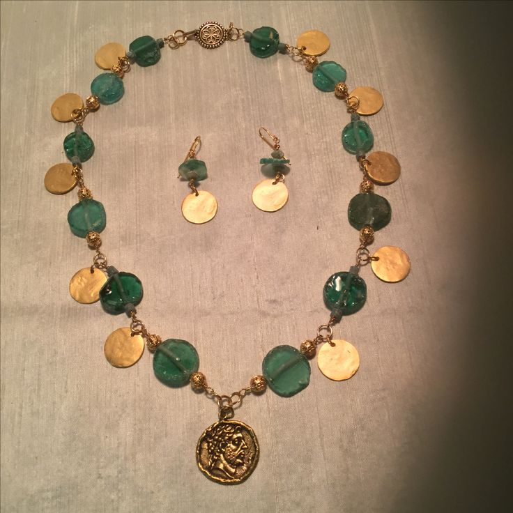 As I noted I love Roman glass. This is a sample of reproduction Roman jewelry I made with Roman glass beads.