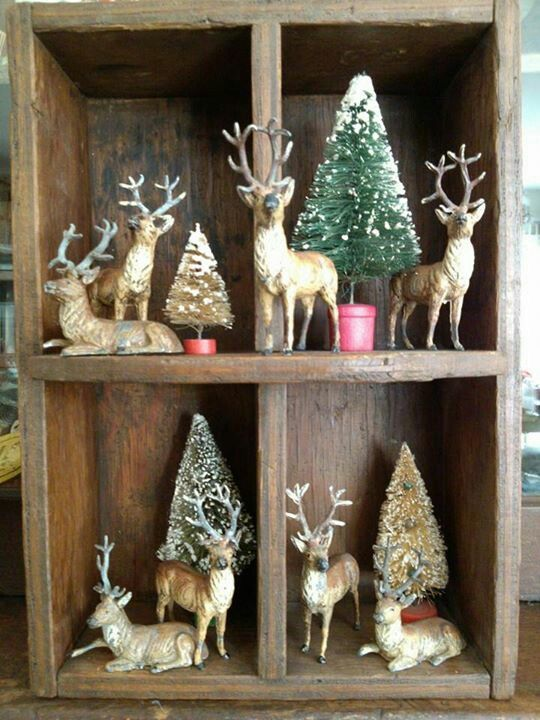 Old wooden crate decorated with bottle brush trees and deer for Christmas and winter holidays. love this!