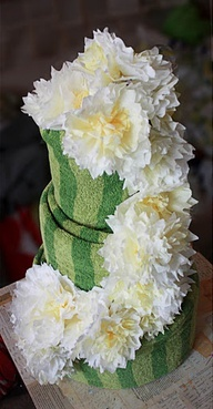 Bridal Shower Centerpiece --towel cake decorated with coffee filter flowers. Use bath sheets
