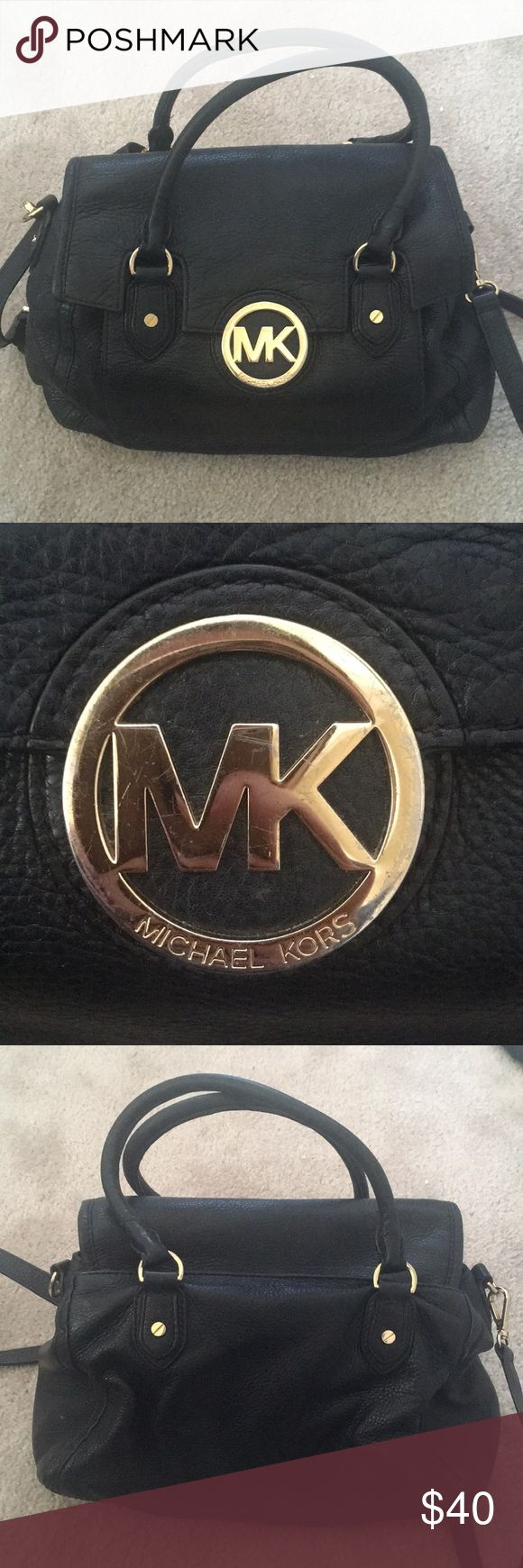 Loved Michael Kors Black bag with satchel strap Perfect work bag for the new grad - soft black leather and lots of compartments. Used for about a year.  Wear on logo detail (see picture). KORS Michael Kors Bags Shoulder Bags