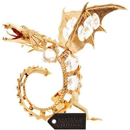 Las historias de dragones han pervivido a través de mitos y leyendas desde antiguo. Su pavorosa belleza y su poder son cautivadores, siendo un icono de fuerza y ferocidad. Elaborado con materiales de calidad como el oro de 24 k con incrustaciones de cristales de precisión Matashi® DIMENSIONES: 15 cm de alto x 12,5 cm de ancho.