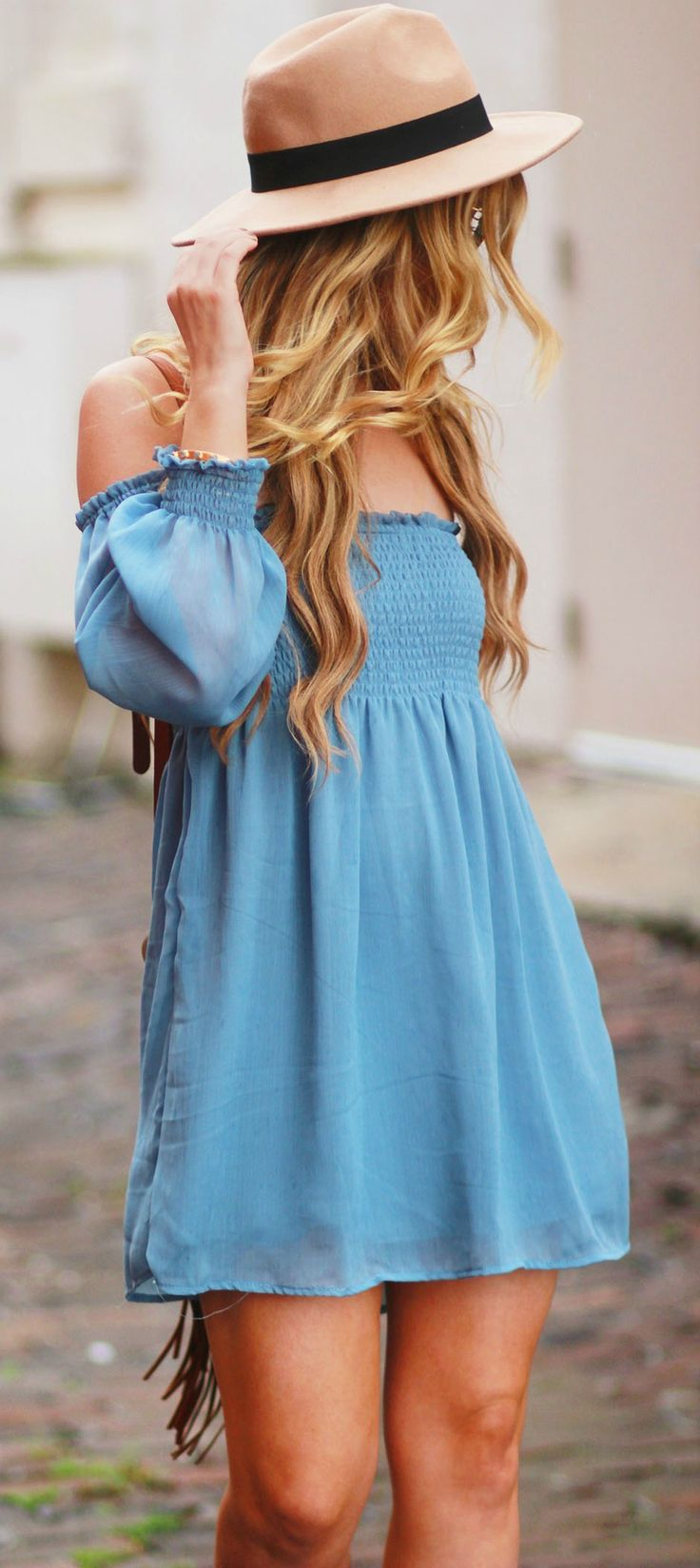 Fall transition outfit styled with a boho off the shoulder dress, brown peep toe booties, fringe crossbody bag, and Ray Ban Icons