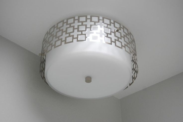 Jonathan Adler light fixture-- perfect nod to MCM (good for bath remodel)