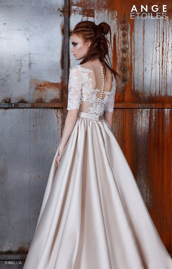 Wedding dress SIBILLA, Wedding dresses A-line, Wedding dresses ball gown, Wedding dresses 3/4 Sleeves We are glad that you are interested in our dresses! We make dresses in order that each girl had the opportunity to choose for herself a special dress with a unique pattern which would emphasize her individuality in the most exciting time.   → Measurements:  All our dresses are made in standard sizes according to the table below:  Size ----------0------- 2 --------4-------- 6 --------8…