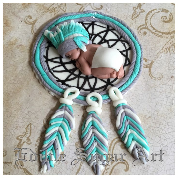 "Native American tribal theme cake topper 1 fondant baby 2 1/2"" long in diaper and headdress dream catcher base 4"" and feathers 2"""
