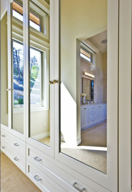mirrored closet doors for the guest room and office with drawers below. possibly change out mirrors to frosted glass.