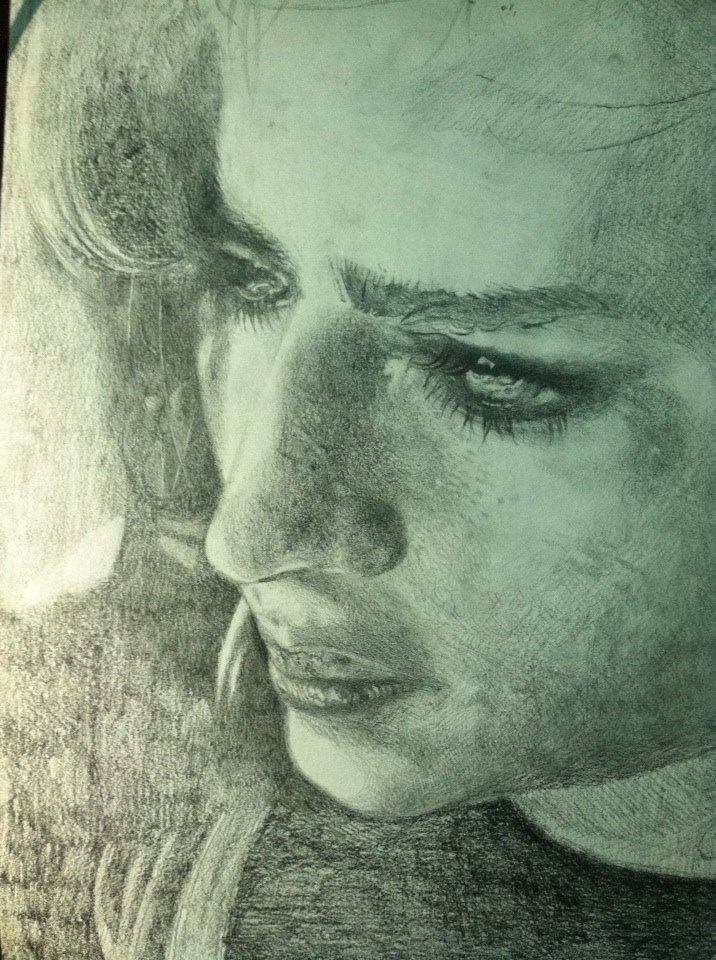 Pensive girl look, is a portrait drawing from a high contrast black and white photograph that I found on Flickr. I use Prismacolor woodless graphite sticks to create shadows and mechanical pencil for detail. Drawing a portrait is challenging, because the face has 3 main elements that are close together, but so distinct from one another in their shape, form and expression (These are the eyes, nose and lips.)