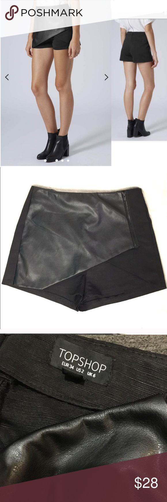 "Topshop PU Ottoman Zip Skort Faux leather asymmetrical skort from Topshop. No condition issues, worn once. Length down side is 12"". Waist is 13"" flat. From their website: PU and ottoman mix skort with wrap and zip detail. 100% Polyester. Machine washable. Topshop Shorts Skorts"
