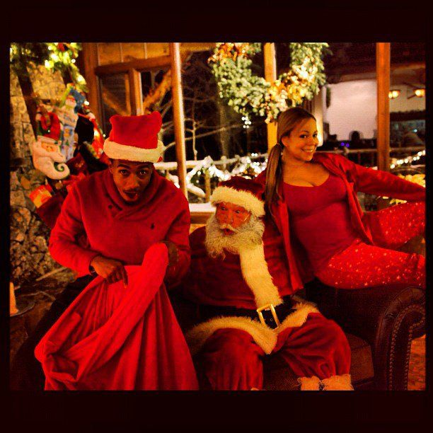 Pin for Later: Get Festive For the Holiday Season With the Cutest Celebrity Christmas Snaps of All Time!  In 2012, Nick Cannon and Mariah Carey posed with Santa.