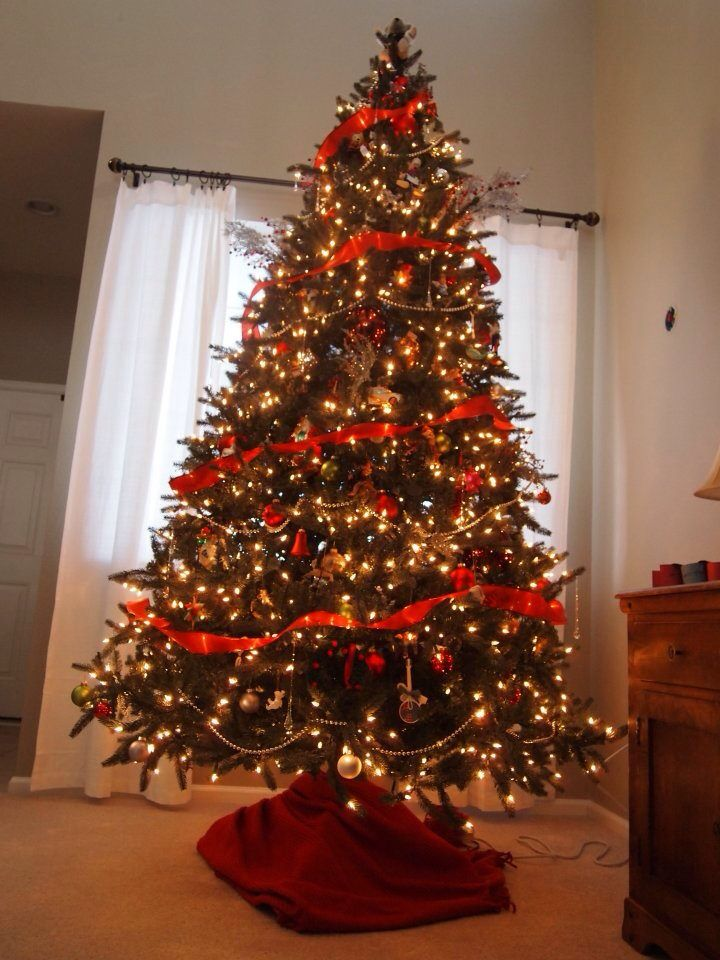 9 Foot Christmas Tree - white lights, red ribbon garland and silver bead garland - and then ornaments galore.