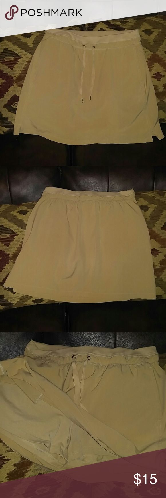 EUC Green Tea Yoga Skirt w/built in shorts Sz M This tan yoga skirt from Green Tea is in EUC. Has hidden pockets and built in shorts, draw string waist and very cute and comfy! Size M. green tea Skirts Mini