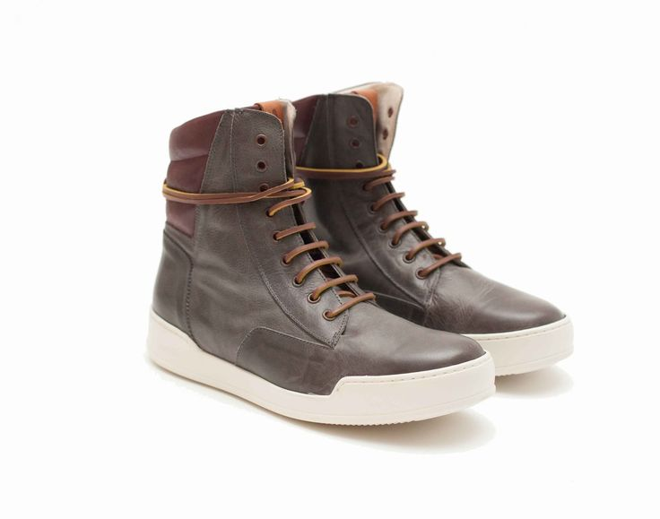 Avvikk - SSCARE Smoke Lace up leather boots with padded collar and oversized padded tongue. Hard-wearing rubber sole with lasered logo. Raw hide laces, eyelets with oxidized effect. Tan leather lace guide with embossed branding.