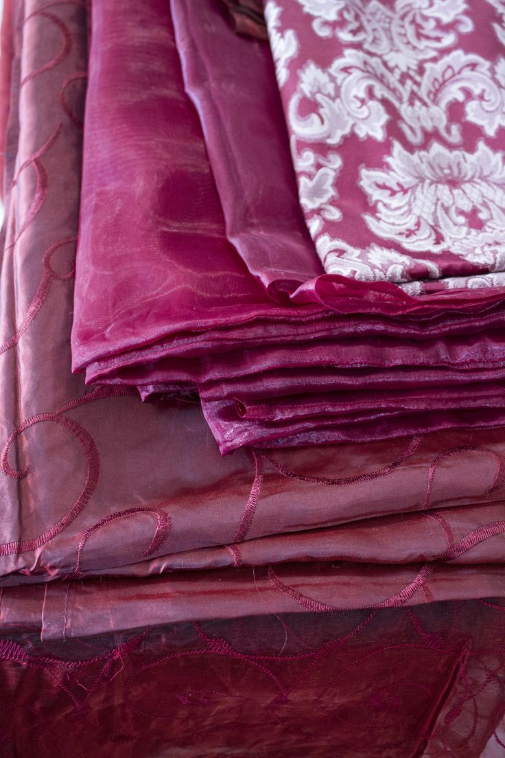 Beautiful ruby purple pink warm coloured linen for hire.