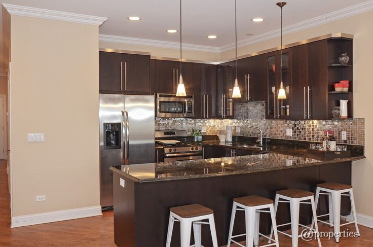 Contemporary Kitchen with Frigidaire - gallery 1.7 cu. ft. over-the-range microwave - stainless-steel, Crown molding, Flush