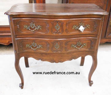 Antique French carved walnut chest of drawers -- bed side cabinet