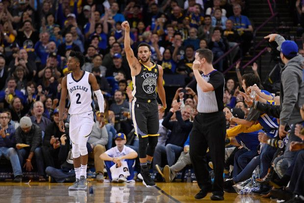 Golden State Warriors' Stephen Curry (30) reacts after making a three-point basket past Memphis Grizzlies' Kobi Simmons (2) during the third quarter of their NBA game at the Oracle Arena in Oakland, Calif., on Saturday, Dec. 30, 2017. Golden State defeats Memphis 141-128. (Jose Carlos Fajardo/Bay Area News Group)