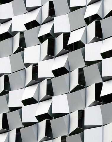 Charles Street Car Park by Allies and Morrison Architects. The abstract and animated surface of its facade is composed of identical angled panels that are rotated randomly in four orientations