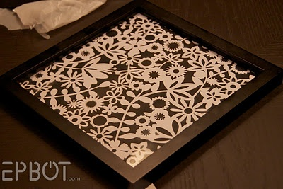 "Cheap ""artwork"". scrapbook paper in frame. This would be great to add with a  wall full of photos"