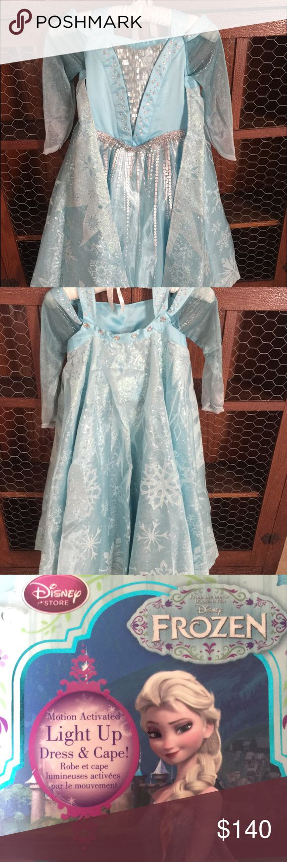 Beautiful Elsa costume. well made and never worn. Very well made, never worn Elsa dress/costume. Pictures do this dress no justice. disney store Costumes Halloween