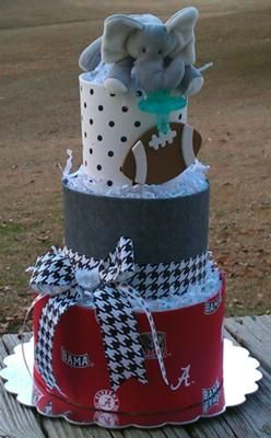 Alabama football diaper cake: I do custom diaper cakes for any baby shower. The toppers are animal pacifiers. They stay close to baby, are hard to lose and easy to find. To clean just