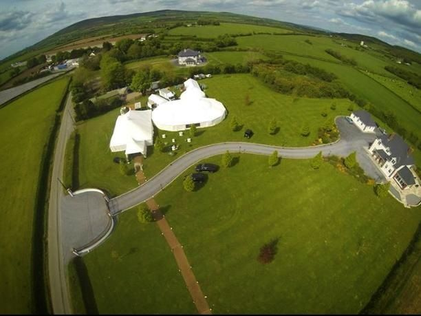 An aerial view of our Orangery and Traditional Canvas Pole Tent with some Top Hats and Yurts thrown in for good measure.