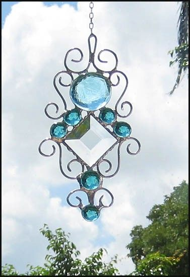 "Aqua Glass Nugget Stained Glass Suncatcher - 4 1/2 x 8""- 201-AQ. $22.95, via Etsy."