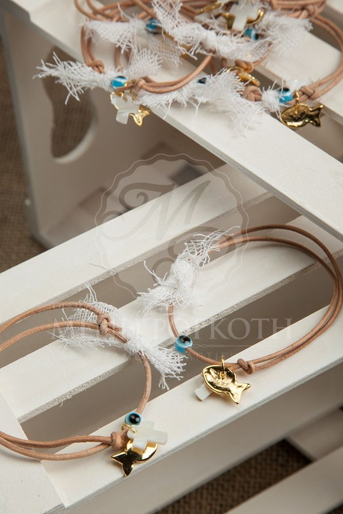 Elegant witness bracelets with mati and fish
