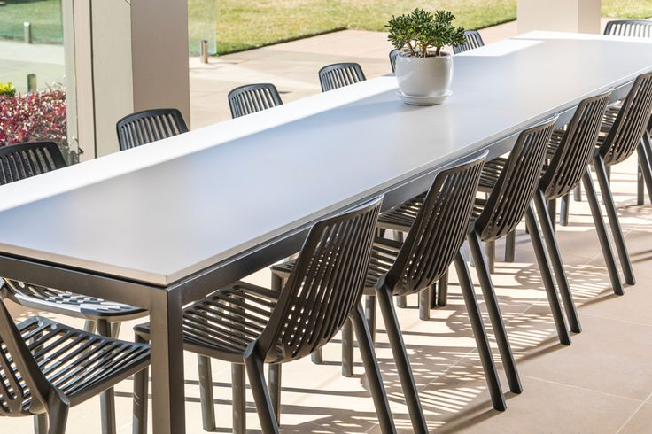 Fancy a party? This grand outdoor dining table was custom made to seat 16 people! Should be a fun summer!