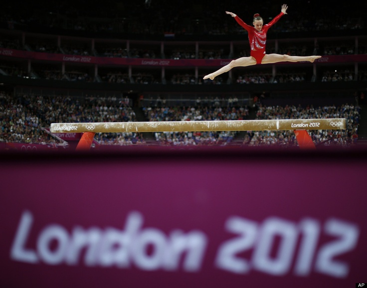 Gymnast Rebecca Tunney from Great Britain performs on the balance beam during the artistic gymnastics women's qualifications at the 2012 Summer Olympics, Sunday, July 29, 2012, in London.