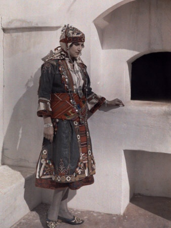 Woman in Costume Stands by Outdoor Oven Styled after Those of Skyros - Maynard Owen Williams